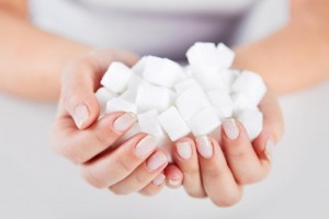 a-woman-holding-sugar-cubes